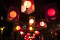 Red lanterns above entrance to the shop. Royalty Free Stock Photos