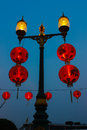 Red lanterns lamp poles with hanging Royalty Free Stock Photos