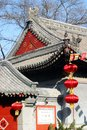 Red lanterns and temple roof Stock Image