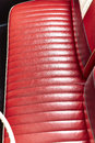 Red leather bench seats in retro  classic car Royalty Free Stock Photo