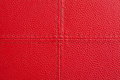Red leather with cross sewing background close up from stool Stock Image