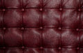 Red leather texture closeup shot of sofa chair or wall Royalty Free Stock Photography