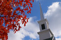 Red leaves church steeple Stock Photo