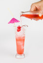 Red lemonade with party straw in hand on white Royalty Free Stock Image