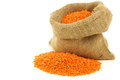 Red lentils in a burlap bag Stock Photography