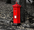Red letter box in autumn park. Royalty Free Stock Photo