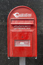 Red letter box dubai emirati dusted with sand united arab emirates Royalty Free Stock Photo
