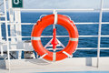 Red life buoy on side of cruise liner Royalty Free Stock Photography