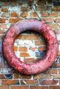 Red lifebuoy on brick wall Royalty Free Stock Photo