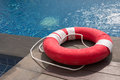 Red lifebuoy the near the swimming pool Royalty Free Stock Photos