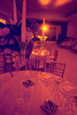 Red light ballroom wedding tables and candles Royalty Free Stock Photography