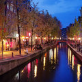 Red light district in amsterdam old houses along canal the of north holland the netherlands Stock Photos