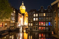 Red light district at night, the Church of St. Nicholas is visible in the distance, the Netherlands. Royalty Free Stock Photo