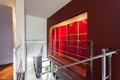 Red lighted wall in modern house and staircase Stock Image