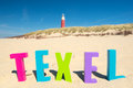 Red lighthouse at the coast from Texel Royalty Free Stock Photo