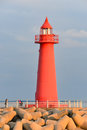 Red Lighthouse in the evening sun Royalty Free Stock Photo