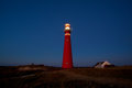 Red lighthouse in the night Royalty Free Stock Photo