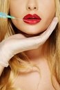 Red lips with Botox syringe Royalty Free Stock Photo