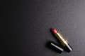 Red lipstick  on black background, Cosmetics concept, Ma Royalty Free Stock Photo
