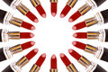 Red Lipsticks making a circle on white background Royalty Free Stock Photo