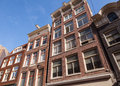 Red living houses facades in amsterdam netherlands with blue sky Royalty Free Stock Photography