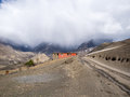 Red lodge with the outcast weather at the mountain at distance behind annapurna conservation area nepal Royalty Free Stock Photo