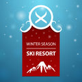 Red logotype winter season ski resort on blue background Royalty Free Stock Photography