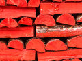Red logs stacked pile of split painted Royalty Free Stock Photos