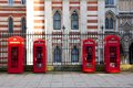 Red london phone booths symmetric arrangement of telephone in england Royalty Free Stock Photos