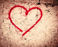 Red love heart hand drawn on brick wall grunge textured background trendy street style Stock Photography