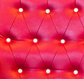 Red luxury vintage style leather with button texture from sofa Royalty Free Stock Image