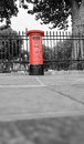Red mailbox british in the street in london Royalty Free Stock Photos