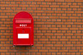 Red mailbox on stone wall Royalty Free Stock Photo