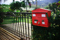 Red mailbox in the tropics Royalty Free Stock Photo