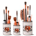 Red makeup brushes, mascara, comb, cotton buds