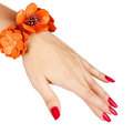 Red manicure and orange bracelet Stock Photography