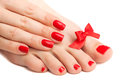 Red manicure and pedicure with a bow. isolated Royalty Free Stock Image