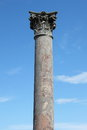 Red marble corinthian column in ostia antica the old harbour of rome italy Stock Image