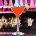 Red Martini Cocktail drink in a bar or disco Royalty Free Stock Photo