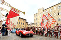 A red Maserati 300 S spider Fantuzzi, followed by a blue Porsche 356 Speedster, takes part to the 1000 Miglia classic car race Royalty Free Stock Photo