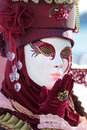 Red mask sending a kiss at Carnival of Venice Royalty Free Stock Images