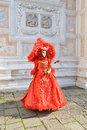 Red mask and venetian architecture the beauty of the carnival to explore the city of venice with its amazing monuments enjoy the Stock Photos