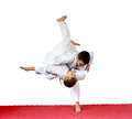 On a red mat athletes are training judo throws Royalty Free Stock Images