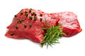 A red meat with rosemary isolated on white background Royalty Free Stock Image