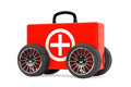 Red medical case on wheels a white background Royalty Free Stock Images