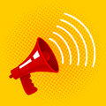 Red megaphone on yellow background.