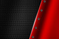 Red metal background with rivet on gray metallic mesh.