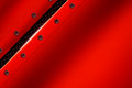 Red metal background with rivet on gray metallic mesh. Royalty Free Stock Photo
