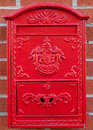 Red Metal Mailbox on brick wall Royalty Free Stock Image
