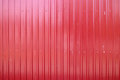 Red metal texture, corrugated steel background Royalty Free Stock Photo